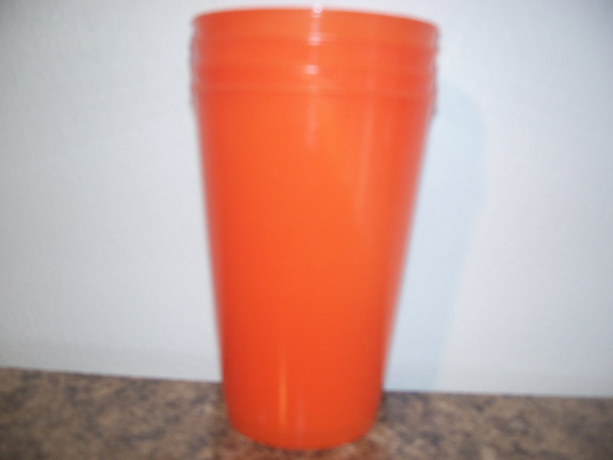 Drinking Glass (plastic, orange in color)