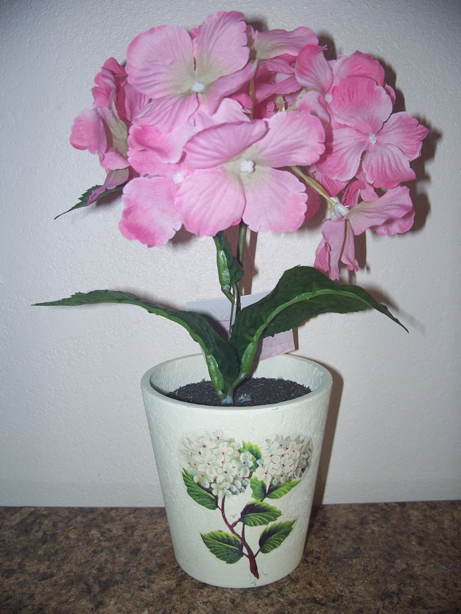 Pink Decorative Flower in White Pot With Flower